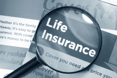 Image of magnifying glass over the words Life Insurance